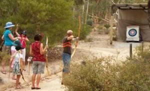 Family having a go at archery
